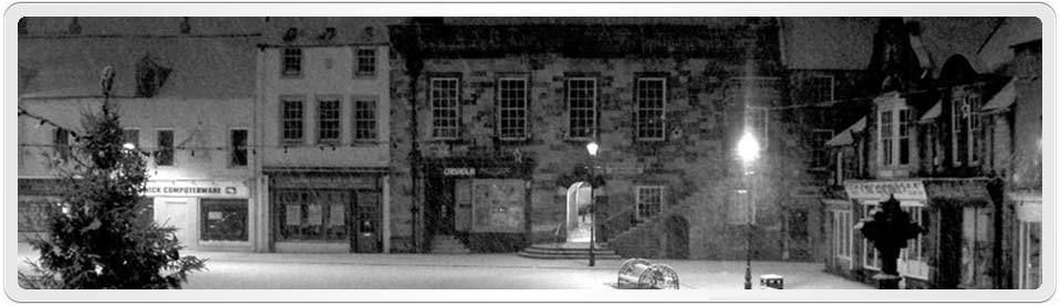 Both Andrew Hindmarsh & Eleanor Reed were born in Alnwick, Northumberland, England. This photo by Andy Armstrong shows the Alnwick marketplace on a snowy night in 2006.