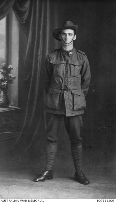 Studio portrait of 2594A Private (Pte) Nesbitt Black, 25th Battalion, of Dunoon, NSW.