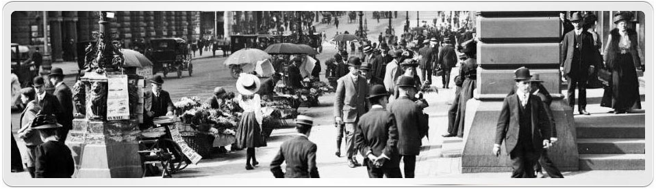 Photo of Martin Place, Sydney in September, showing stall vendors, old cars and many people going about their business.