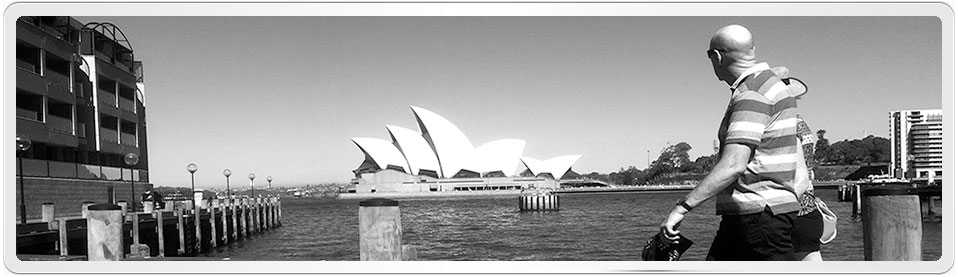 Photo of Sydney Opera House admired by passers by